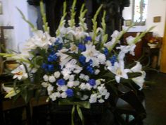 Blue and white church flowers Church Flowers, Flower Arrangements, Blue And White, Wedding Ideas, Plants, Floral Arrangements, Plant, Wedding Ceremony Ideas, Planets