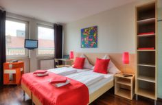 bedroom at  MEININGER Hotel Munich City Center #meiningerhotel München