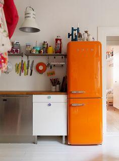 Orange fridge. Eclectic kitchen