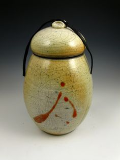 This elegant one-of-a-kind Peaceful Home Raku style individual size urn has an aged look and is inspired by forms and textures of the earth. Find it at http://www.artisurn.com/collections/raku-style-urns/products/peaceful-home-raku-style-individual-size-urn. #raku #urn #rakuurn #handmade #home