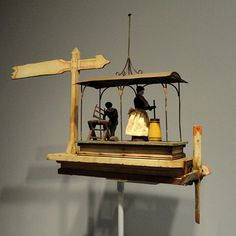 Whirligig with Woman Churning and Man Sawing, 1920s, artist unknown