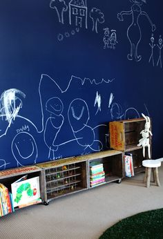 crate shelving in playroom + chalkboard wall