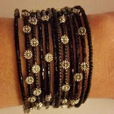 Matte and Shiny black seed beads and silver flowers on memory wire