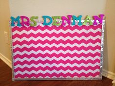 My new bulletin for my classroom!  I used chevron fabric, sequined ribbon, pre-made wooden letters, and then I hot glued little gems to my ordinary pushpins.