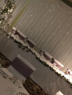 Aubergine , top table sashes dressed to the side with a beautiful twinkle backdrop