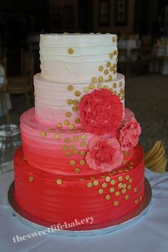 Not a fan of the flowers and the gold dots, but I am a fan of ombre cakes.