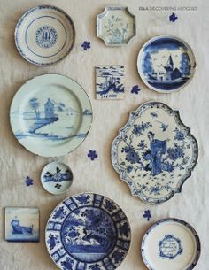 a collection of blue and white plates