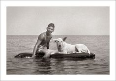 Boy and his dog floating on water.