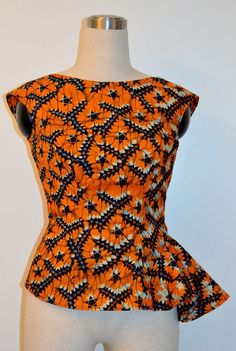 African print low back top. African fabric orange top by Rahyma ~Latest African… African Blouses, African Tops, African Dresses For Women, African Print Dresses, African Print Fashion, African Attire, African Wear, African Fashion Dresses, African Women