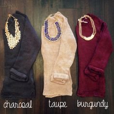 LOVE this basic sweater with statement necklaces