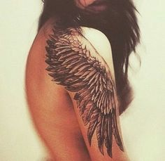Wing Tattoo on Shoulder and Upper Sleeve.