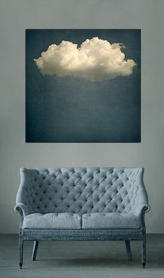 tufted settee...the cloud art is pretty cool, too.