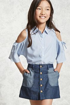 Forever 21 Girls - A denim skirt featuring a button front closures, contrast slanted front pockets, and belt loops.
