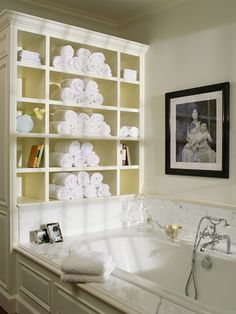 Built in shelving for towels, soaps and books behind tub. | fabuloushomeblog.comfabuloushomeblog.com