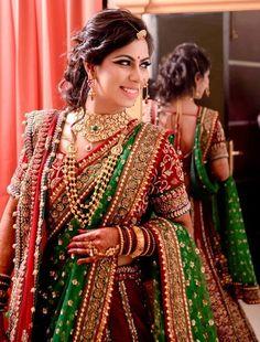 maroon and green, deep red velvet bridal lehenga, winter night reception, double dupatta, haurstyle, jewellery layered, velvet panels, royal, regal, ornate, heavy, choker necklace with long raani haar