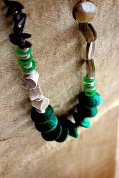 """Balungi green touched necklace   """" Certain things catch your eye, but pursue only those that capture your heart """"  ...The Balungi flagship Store is slowly taken over by blue and green and  a touch of silver...Moreover Balungi """"HEART YOU.""""...blue is the new red for valentine!"""