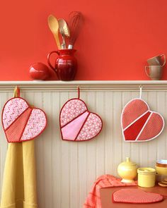 Area to hang kitchen potholders... make some for each season so you can hang as functional decor