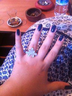 puzzle ring, navy blue nail polish