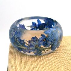 love this resin bangle made with real flowers