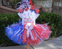 What a Beautiful outfit for that little ones 4th of July. Great for parties, Cake smash, Pictures, Birthday.  This is a 3 piece Set Romper choice of headband 1 or 2 Bloomers  Applique Romper can be worn with or without the Ruffled Bloomers. Applique Romper has the words. Red White and Cute with red, crystal, and Blue Swarovski Rhinestones along the neckline and through out the design. The neckline has a Ruffled neckline and the legs have Red,White and Blue Stars around the Ruffled bottom…