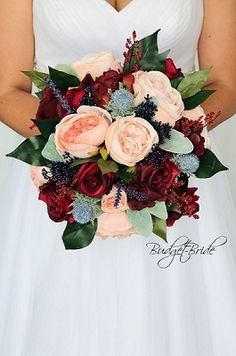 Burgundy, peach and navy blue wedding brides bouquet perfect for a fall themed wedding with lots of greenery