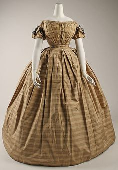 Dress  Date: ca. 1860 Culture: American Medium: silk, cotton Dimensions: [no dimensions available] Credit Line: Gift of Miss Emma Hunt, 1937 Accession Number: C.I.37.28.4
