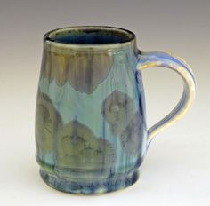 It's hard to imagine that you could actually drink out of this gorgeous Java Mug Flambeaux from potter Bill CampbellFlambeaux glazes are known for their subtle color variations, random occurrences and impressionistic appearance. Your imagination will find