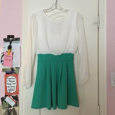 "Green/White Dress w/ Bow Detail on Back Adorable dress with a semi-sheer top and a green textured bottom! Low cut back with a cute bow detail. Only worn for 2 hours for an awards banquet. Hits mid thigh (I am 5' 5"") and is very comfortable! a'gaci Dresses"