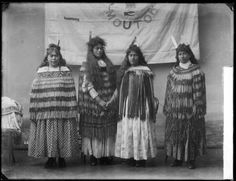 Maori women standing in front of the Moutoa flag - Photograph taken by William Henry Thomas Partington
