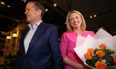 Opposition leader Bill Shorten gives Chloe Shorten a bunch of orange roses during a street walk at Westfield Carindale in Brisbane which falls within the Federal electorate of Bonner this afternoon, Tuesday 31st May 2016.