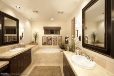 Contemporary Master Bathroom with limestone tile floors, Master bathroom, European Cabinets, Drop-In Sink, Wall sconce, Flush