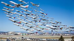 """LAX Takeoff photo-Architectural photographer and """"aviation geek"""" Michael Kelley decided on one smog-free Sunday morning to spend the day photographing the action at LAX. Perched on top of the hill at Clutter's Park with camera in hand, Kelley spent seven hours baking under the California sun. Tired and sunburned, he took over 400 pictures, and they would serve as the basis for the amazing photo."""