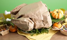 Paper Bag Turkey: Popcorn stuffed anything is a great dish for the kid's table! Idea from One Charming Party