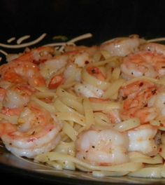 Garlic Shrimp Pasta: 1 lb medium shrimp, deveined and tails removed 1 lb spaghetti noodles (more or less, depending on family size) 6 -8 garlic cloves, according to personal taste, minced 1/4 cup butter olive oil (3 drizzles) italian seasoning fresh ground pepper red pepper flakes salt herbs (according to taste)