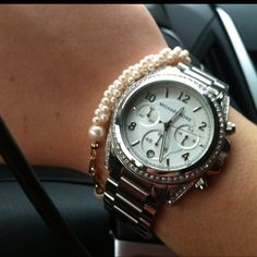 Michael Kors watch. I'm obsessed with it!! Wear it everyday.