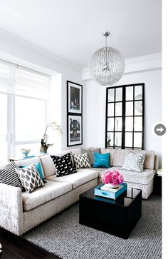Teal and grey living room. Liking the sectional… shows the impact of a great floor mirror. So open!
