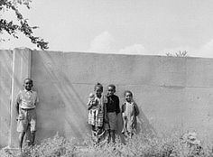 """Original caption: """"Negro children standing in front of half mile concrete wall, Detroit, Michigan. This wall was built in August to separate the Negro section from a white housing development going up on the other side"""" Oval Office, Jim Crow, Civil Rights Movement, African American History, The Other Side, Black People, Black History, The Neighbourhood, The Past"""