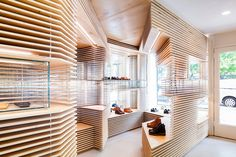 a3ca06acef048c jordana maisie punctuates FEIT shoe shop in new york with layers of wood