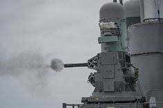 Rounds fire from a Phalanx close-in weapons system (CWIS) aboard the Ticonderoga-class guided-missile cruiser USS Lake Erie (CG 70) during a live-fire exercise.