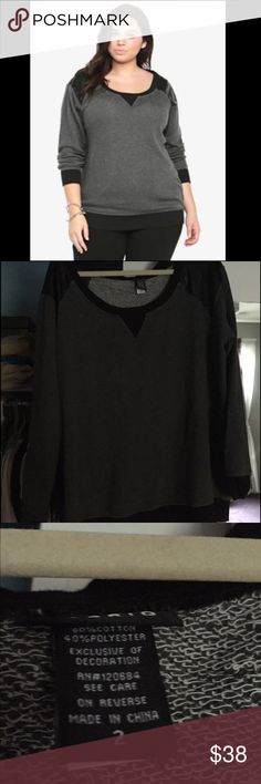 Torrid sweatshirt🌂 NWOT- never worn ever, excellent condition- torrid sweatshirt with faux leather shoulder detail nice terry material. Not sold in stores or online anymore. Pretty black and charcoal color. Looks great with jeans✨ | torrid size 2 = 16/18 torrid Tops Sweatshirts & Hoodies