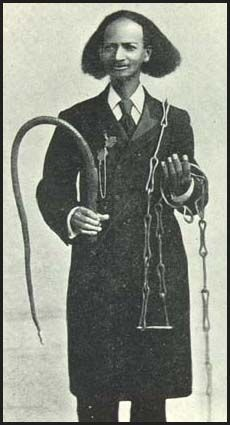 Thomas Johnson–born into slavery in the United States in 1836, emancipated in the wake of the Civil War, and author of Twenty-Eight Years a Slave (1909)–displays some of the whips, shackles and restraints used to control and discipline slaves both in the U.S. and the Caribbean.