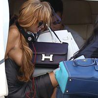 Lindsay Lohan, Brazilian helicopter exit, wardrobe malfunction, side boob exposure