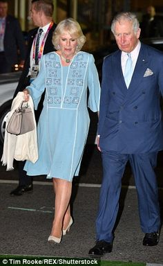 The Duchess of Cornwall teamed her dress with a beige leather tote, suede pumps and a white scarf to ward off the evening chill Camilla Duchess Of Cornwall, Duchess Of Cambridge, Prince Phillip, Prince Charles, Camilla Parker Bowles, Church Of England, Civil Ceremony, Prince Of Wales, Queen Elizabeth Ii