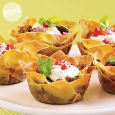 Mini Tacos - Instead of taco shells use wanton wrappers. Put them in a muffin tin coated with non-stick spray, then put your seasoned taco meat in each one. Bake at 350 for 8 minutes. Yum!!