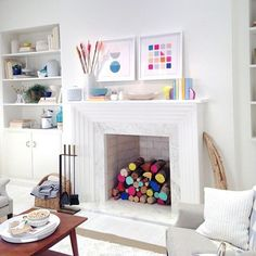 Styling a non-functioning fireplace can be a challenge. Try these 9 clever fixes, all found on Pinterest. | Design:   Emily Henderson