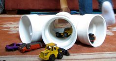 Pretend Play Invitation to Play: 3-way PVC pipe tunnel - pipe fittings and matchbox cars.