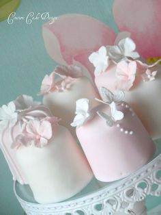 Pink & White Mini Cakes. With Hydrangea, Butterfly and pipe detail. Each cake serves 2.