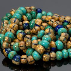 7 inches 4/0 Jade turquoise striped Picasso mix seed beads. Each strand or bag has approximately 52-54 beads in jade greens, striped mottled antique yellow, and cobalt blue. Size: 5 x 3mm Hole: 1mm Yo