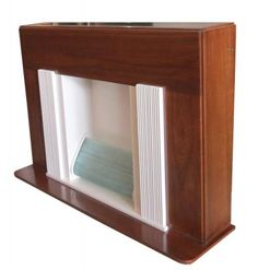 """This sleek American art deco electric fireplace is from the 1930's. The cabinet is mahogany and has a frosted glass inserted top. The """"fire"""" is in a space flanked by ribbed pillars all in white lacquer. The """"fire"""" is twisted rods glass, illuminated from behind."""