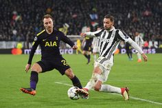 Christian Eriksen of Tottenham battles Mattia De Sciglio of Juventus during the UEFA Champions League Round of 16 First Leg match between Juventus and Tottenham Hotspur at Allianz Stadium on February 13, 2018 in Turin, Italy.
